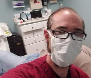 Dr AJ Cummings finishing up a micro needling session